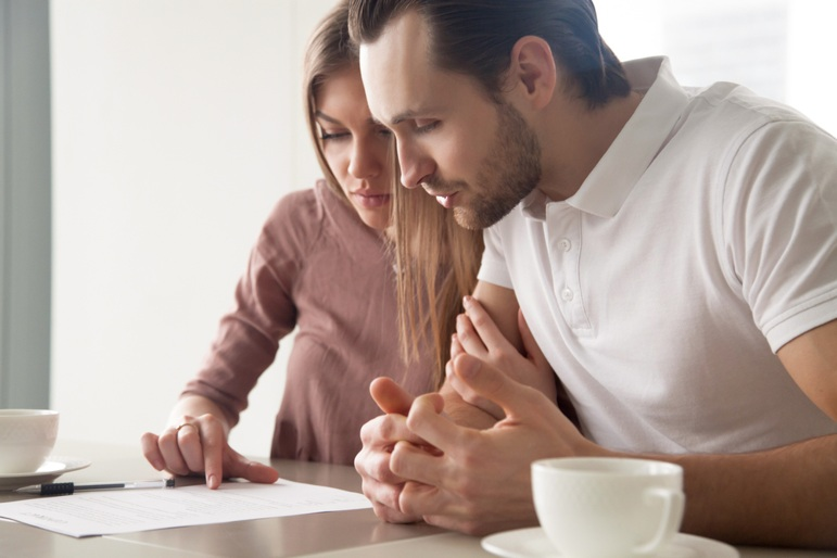 couple-reading-paperwork